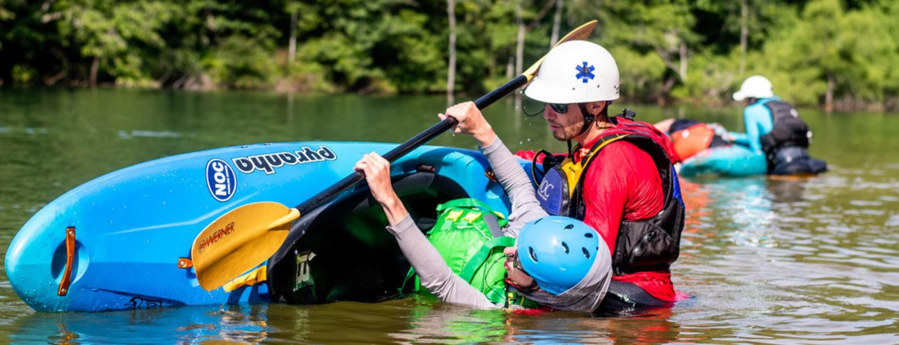 Learning to roll a kayak in paddling school