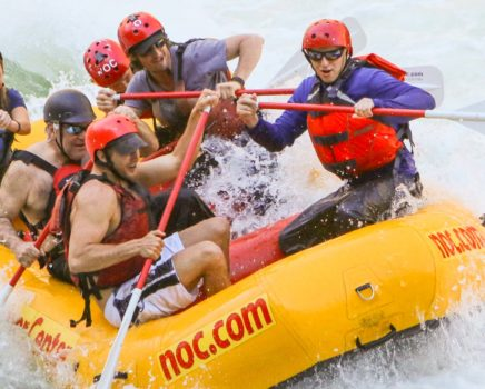 guides rafting in white water during raft guide school