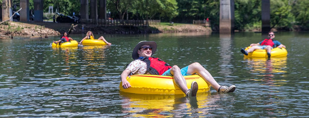 Man tubing on a river in North Carolina