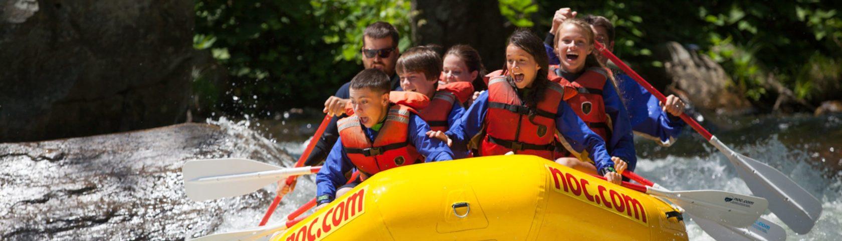 School group rafting on rapids