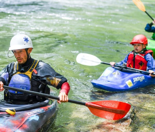 Child and instructor kayaking during Summer Day Camps course