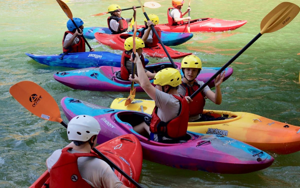 Teens at a kayak Summer Day Camp