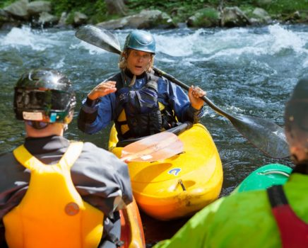 Instructor talking with guests during the Swiftwater Rescue for Whitewater Paddlers course