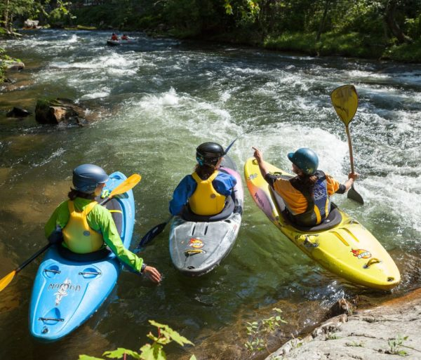 Kayakers scouting during the Swiftwater Rescue for Whitewater Paddlers course