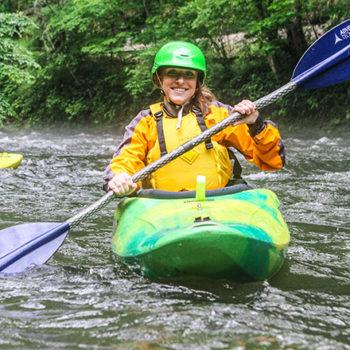 woman white water kayaking
