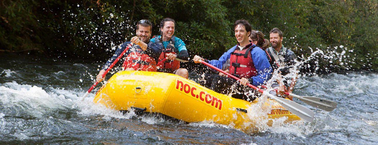 group rafting on rapids