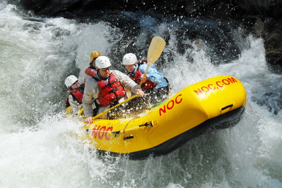 Guests rafting through big water