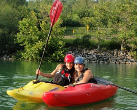 Two women in kayaks on the Women's Weekend Kayak Retreat
