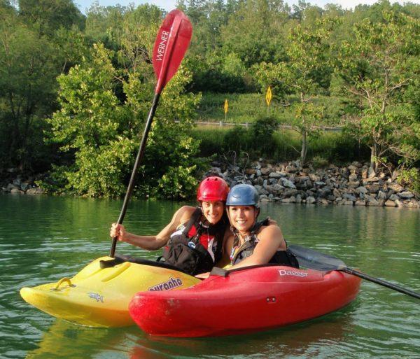 Two women in kayaks on the Women's Weekend Kayak Retreat