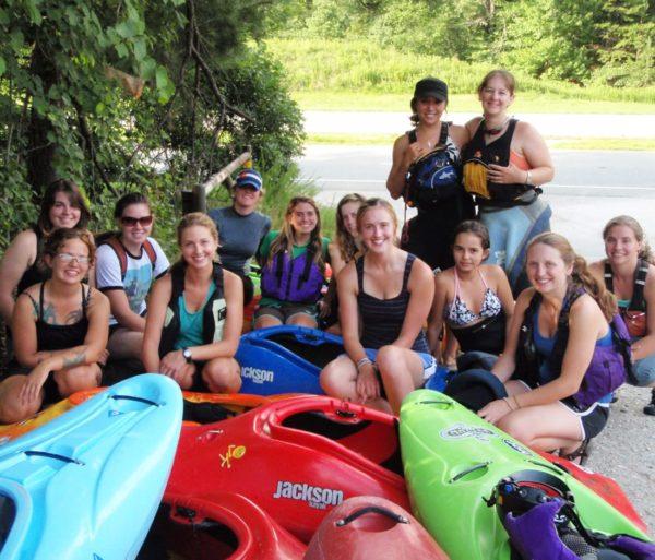 Group of women by kayaks on the Women's Weekend Kayak Retreat