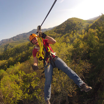 Guest zip lining through mountains