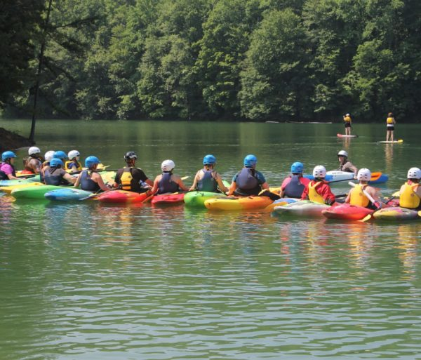 Group of colorful kayakers learning to kayak on the Introduction to Kayaking Course – Chattahoochee River course