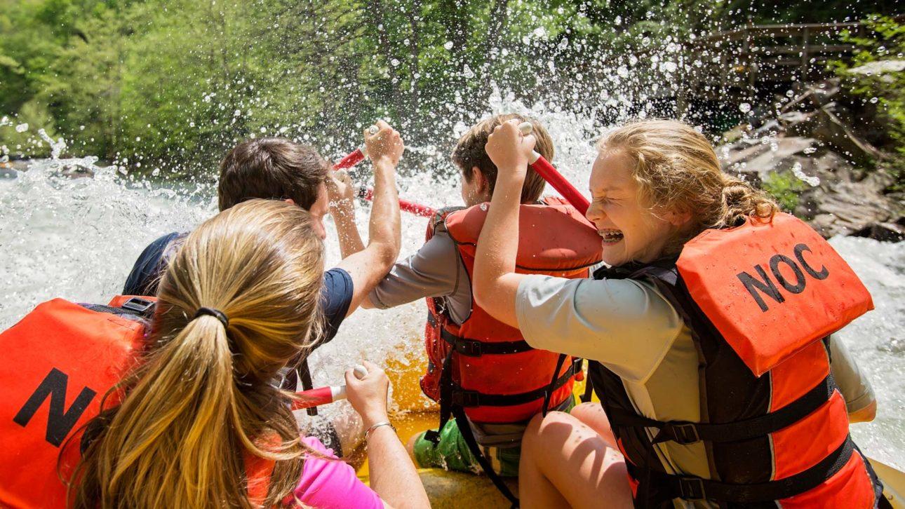 Girls getting splashed while rafting on the Nantahala River Rafting: Fully-Guided in North Carolina trip