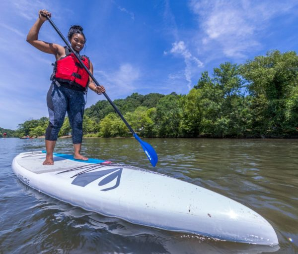 Woman stand up paddle boarding on the Chattahoochee River in Roswell, GA