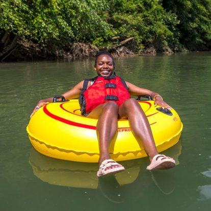 Girl tubing on a river in North Carolina