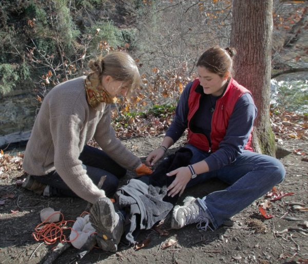 Person wrapping an injury during the Wilderness First Responder (WFR) Certification and Recertification Courses