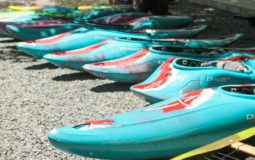 Blue kayaks in a row
