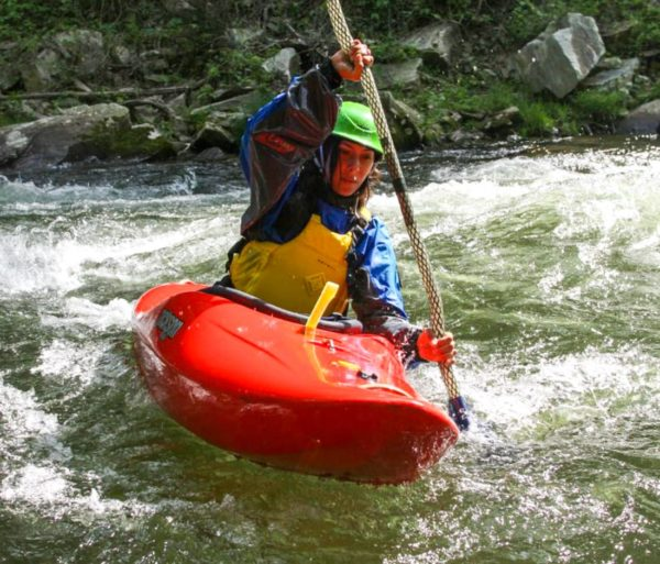 Person kayaking on class 2 rapids