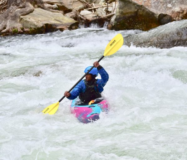 kayaking through class 3 rapids