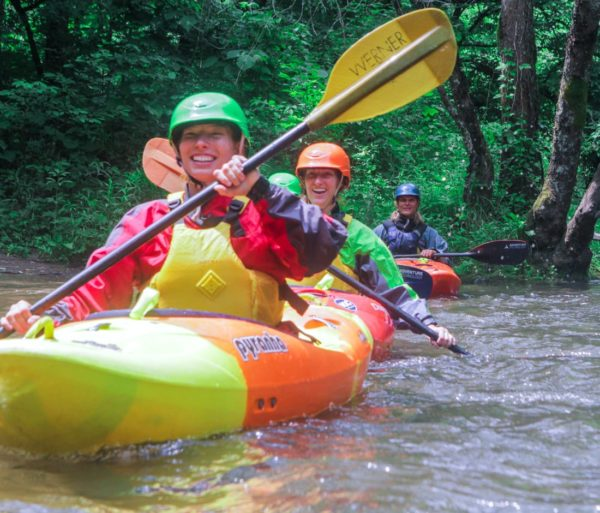 Adults learning to kayak