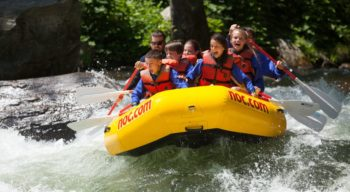 School group rafting on rapids
