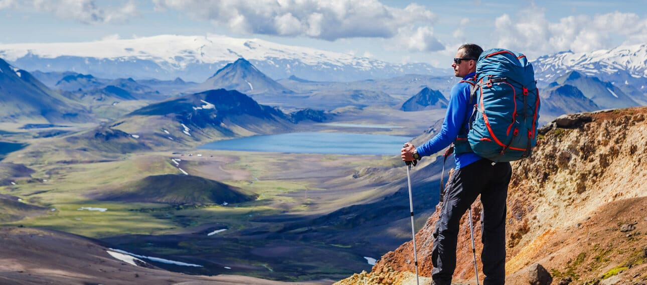 Trekker Overlooking A Mountain Valley In Southern Iceland