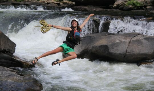 Isabel Blue, NOC Guide jumping into the Chattooga