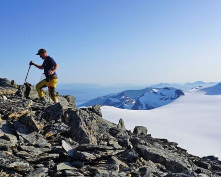 Mountain Climber above the peaks