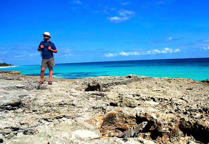 NOC Guide stands along the crystal-clear waters of the Yucatan.