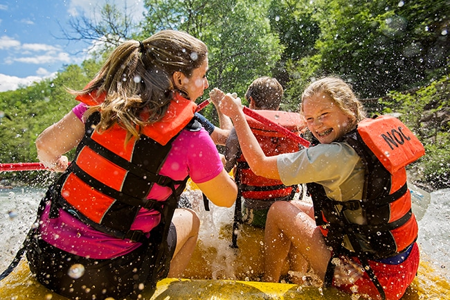 Mom and daughter rafting on the Nantahala with NOC